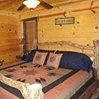 bed in Crazy Horse Cabin at Hochatown Junction in Broken Bow, OK