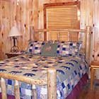 bed in Front Porch Lodge at Hochatown Junction in Broken Bow, OK
