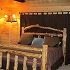 bed in Sugar Shanti Cabin at Hochatown Junction in Broken Bow, OK