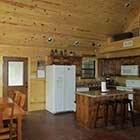 kitchen area in Sugar Shanti Cabin at Hochatown Junction in Broken Bow, OK
