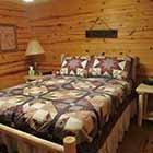 bed in Triple Oaks Cabin at Hochatown Junction in Broken Bow, OK