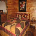 bed in Bear Necessities Cabin at Hochatown Junction in Broken Bow, OK