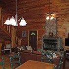Living room in Bear Necessities Cabin at Hochatown Junction in Broken Bow, OK