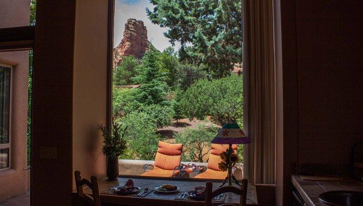 Window View of two Chairs Adobe Village Graham Inn