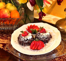 A chocolate dessert with strawberries