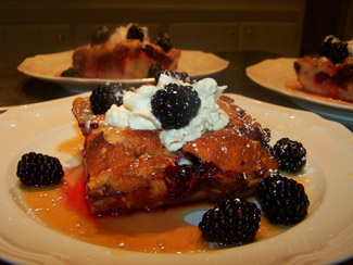 French toast with marmalade, whipped cream, and berries