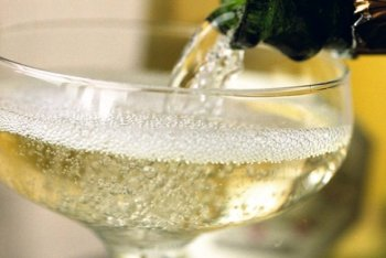 romantic escape champagne being poured into a cup