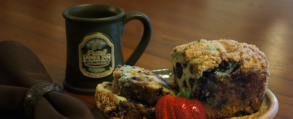 Prescott Pines Inn mugs and breakfast blueberry bread with strawberries