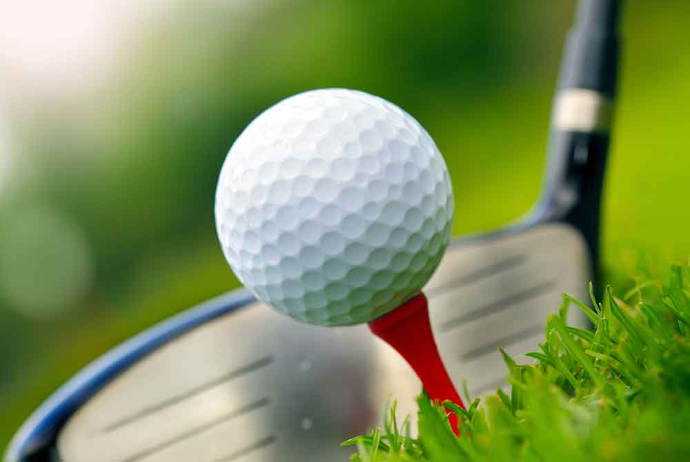 Golf Club Near Golf Ball on Tee