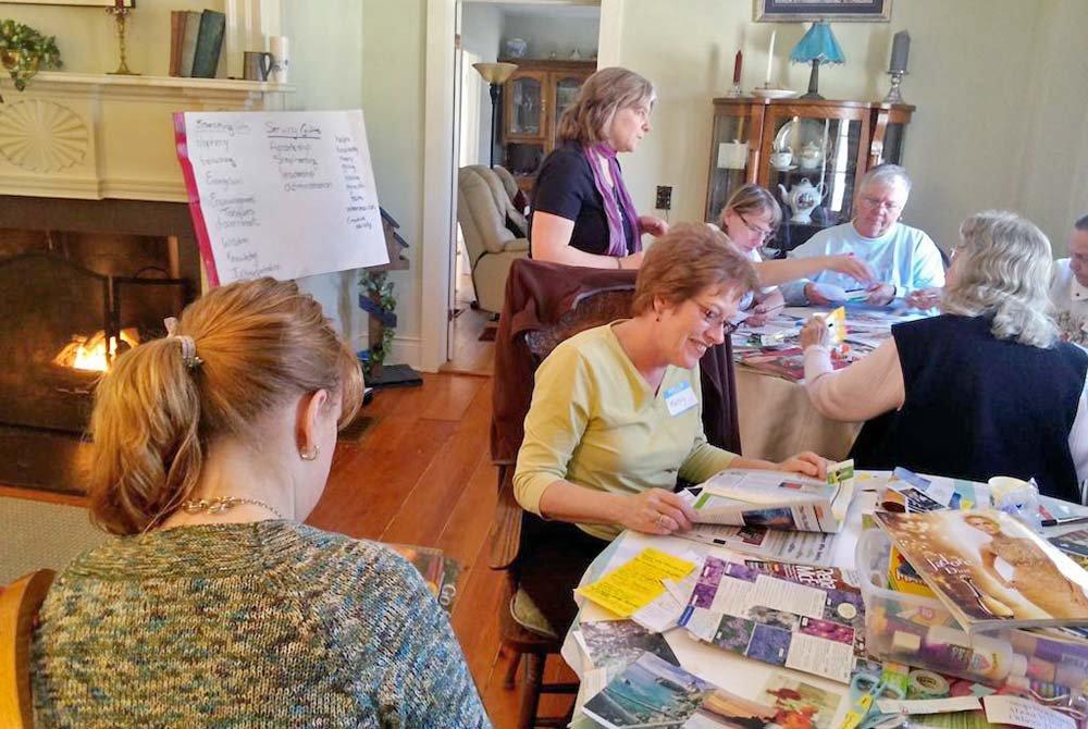 Elderly women piecing together scrapbooks