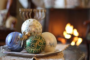 christmas decorations in front of fireplace