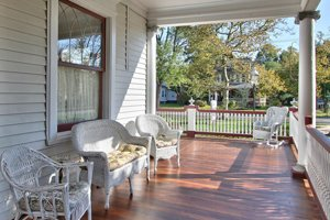 front porch with couches in the shade