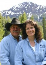 skyline guest ranch owners with mountain and trees