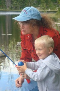 grandma and grandson fishing at lake in Beartooth Mountains