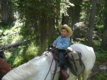 child on horseback at Skyline Guest Ranch near Cooke City, Montana
