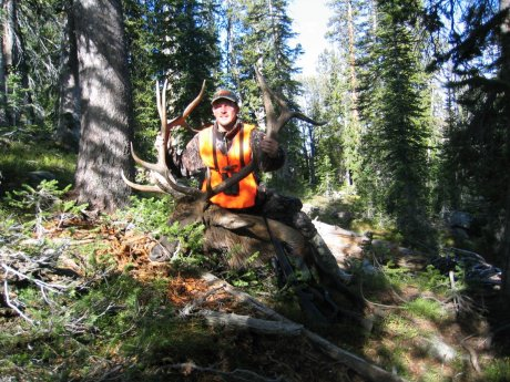 hunter with elk harvested with skyline guest ranch
