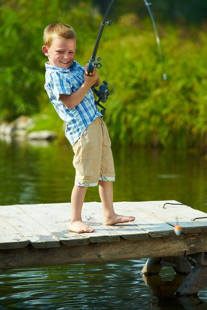 Kid fishing in a lake