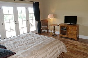 Fox and Hounds Suite bed and french doors in The Inn at Rosehill in Monroe, North Carolina