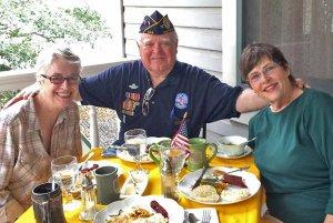 Veteran with women at breakfast