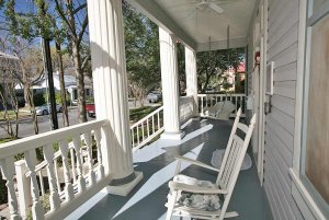 Rocking chair looking out over porch railing