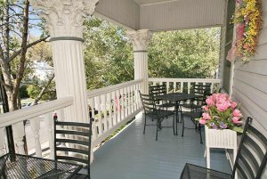Chairs and flowers on front porch