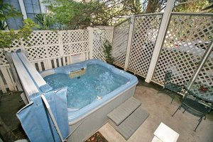 Hottub surrounded by fence