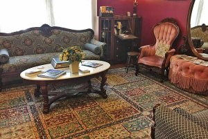 Carpeted seating area with coffee table