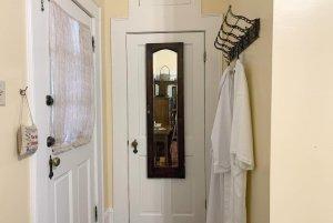 Bathrobes hung on rack in hallway