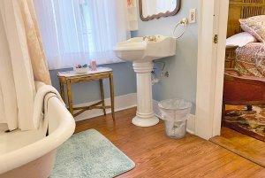 Sink across from bathtub in bathroom