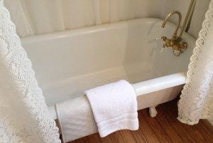 Towel hung on rim of bathtub