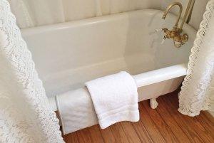 Towels hung on bathtub in bathroom