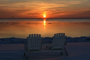 Black Walnut Point Inn outdoor chairs sunset lake
