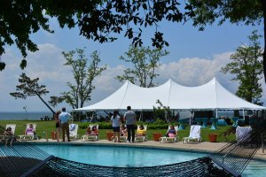 Black Walnut Point Weddings tent next to the pool