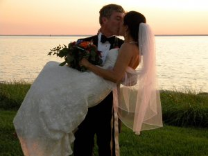 Black Walnut Point Weddings bride and groom kissing sunset