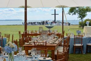 Black Walnut Point Weddings empty tables wedding ceremony in the background