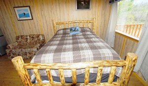 A bed with plaid covers