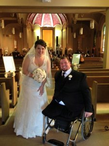 Chapel of the Archangels bride and groom in wheel chair