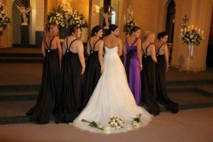 Chapel of the Archangels bride and bridesmaids flowers on wedding dress