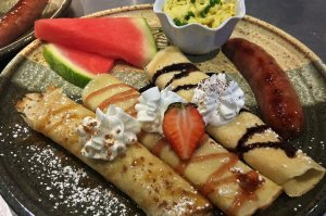 Crepes with fruit and chocolate syrup