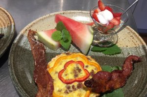 Breakfast tart with bacon, watermelon, and strawberries