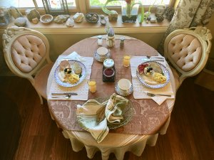 A table set with breakfast for two