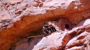 An adobe ruin in an alcove