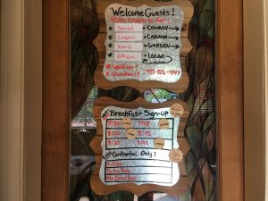 Sign with guest names and breakfast time slots
