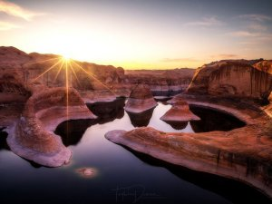 Sunrise over a water-filled canyon