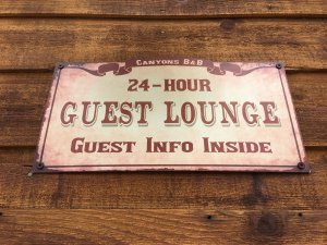 A plaque labelling the guest lounge