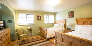 A bedroom with two beds