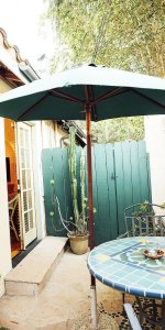 An outdoor table with a shade umbrella