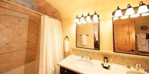 A spacious bathroom with tiled shower