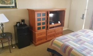 tv and furnishings in king room