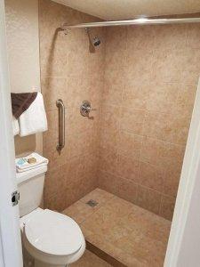 the shower in the double queen deluxe room